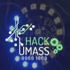 HackUMass logo with electronics in the background